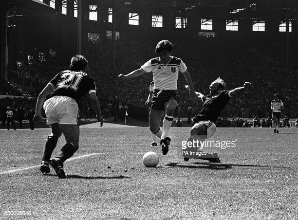 England's Steve Coppell retains possession despite the tackle from Scotland captain Archie Gemmill during the international match at Hampden Park...