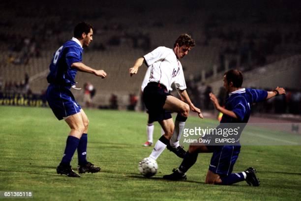 England's Steve McManaman battles with Greece's Angelos Bassinas and Giannis Goumas
