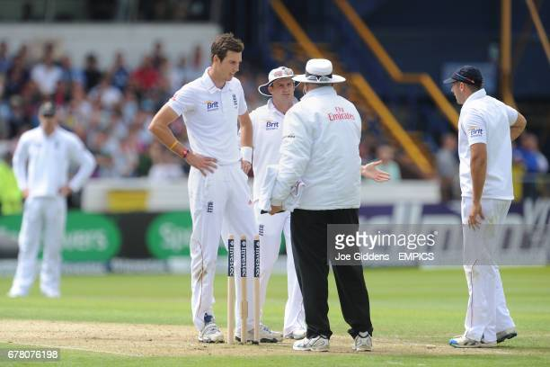 England's Steven Finn and Andrew Strauss appeal to the umpire after a wicket was disallowed as the bales at the bowlers end fell off during bowling
