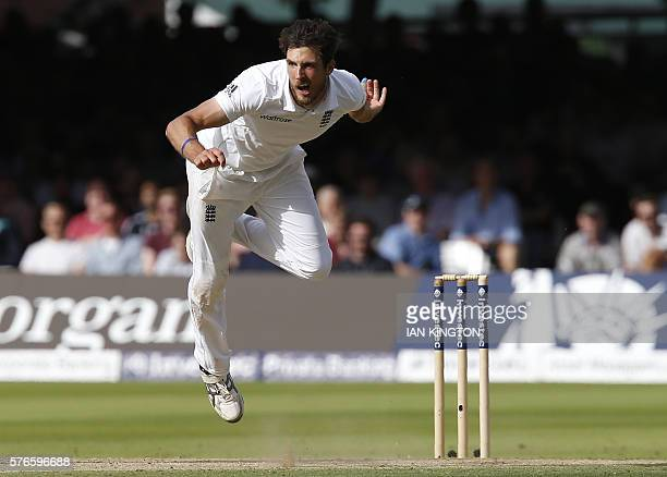 TOPSHOT England's Steven Finn bowls a ball on the third day of the first Test cricket match between England and Pakistan at Lord's cricket ground in...