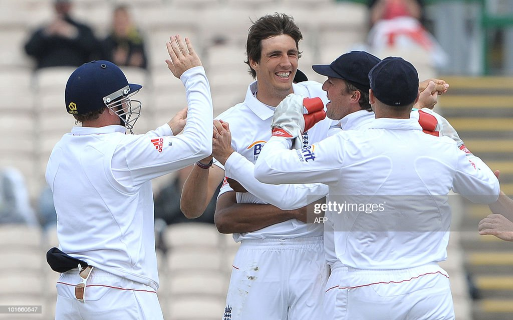 England's Steven Finn (C) celebrates after taking the wicket of Mushfiqur Rahim of Bangladesh during the third day of the second Test match between England and Bangladesh at Old Trafford in Manchester, northwest England, on June 6, 2010.
