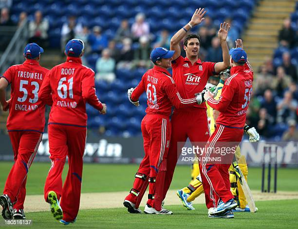 England's Steven Finn celebrates taking the wicket of Australia's Aaron Finch during the fourth one day international cricket match between England...