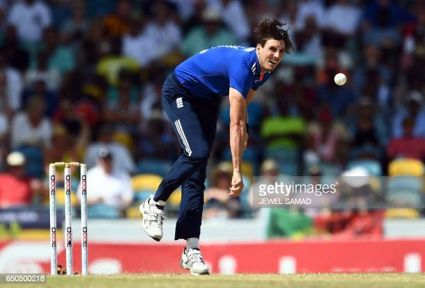 England's Steven Finn delivers a ball during the final of the three-match One Day International series between England and West Indies, at the...