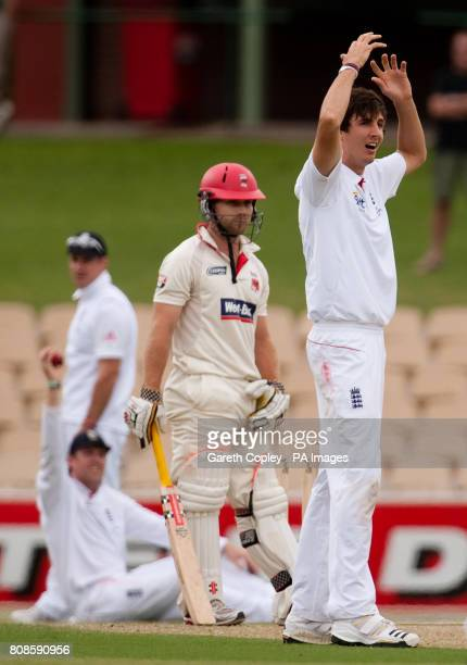 England's Steven Finn reacts after his unsuccessful appeal for the wicket of South Australia's Aiden Blizzard during the tour match at the Adelaide...
