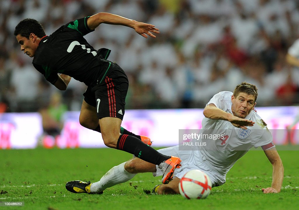 England's Steven Gerrard (R) challenges Mexico's Pablo Barrera during their international friendly football match against at Wembley Stadium in London on May 24, 2010 AFP PHOTO/Paul Ellis