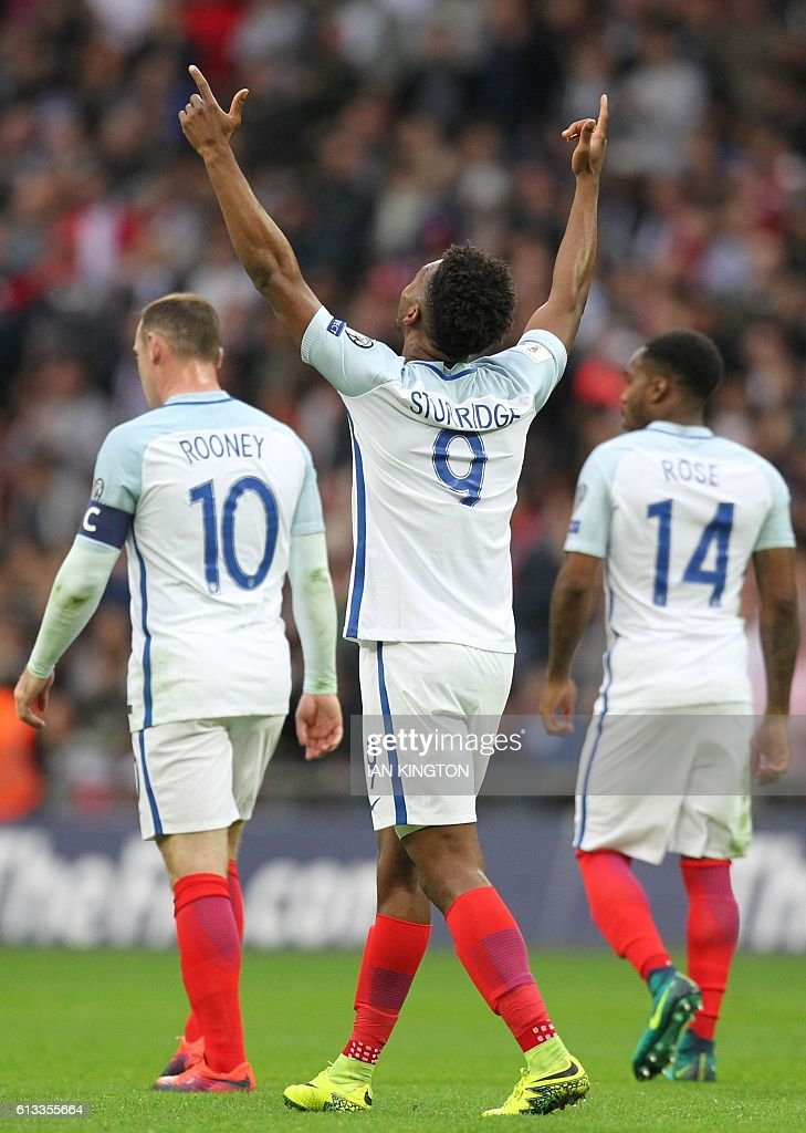 England's striker Daniel Sturridge (2nd R) celebrates after scoring the opening goal of the World Cup 2018 football qualification match between England and Malta at Wembley Stadium in London on October 8, 2016. / AFP / Ian KINGTON / NOT