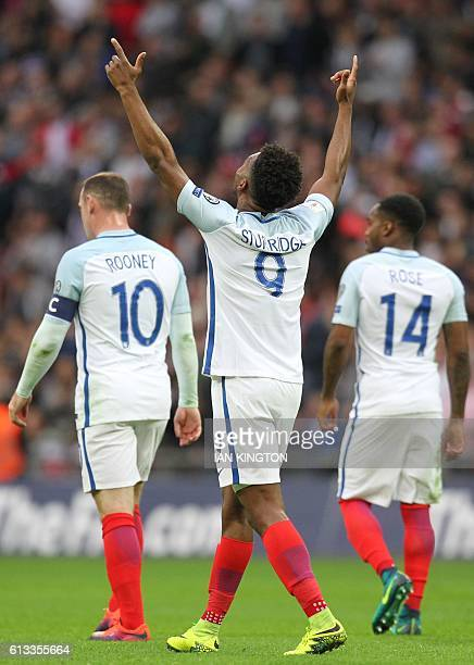 England's striker Daniel Sturridge celebrates after scoring the opening goal of the World Cup 2018 football qualification match between England and...