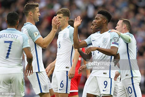 England's striker Daniel Sturridge celebrates with teammates after scoring the opening goal of the World Cup 2018 football qualification match...