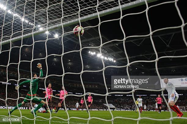England's striker Daniel Sturridge scores past Scotland's goalkeeper Craig Gordon during a World Cup 2018 qualification match between England and...