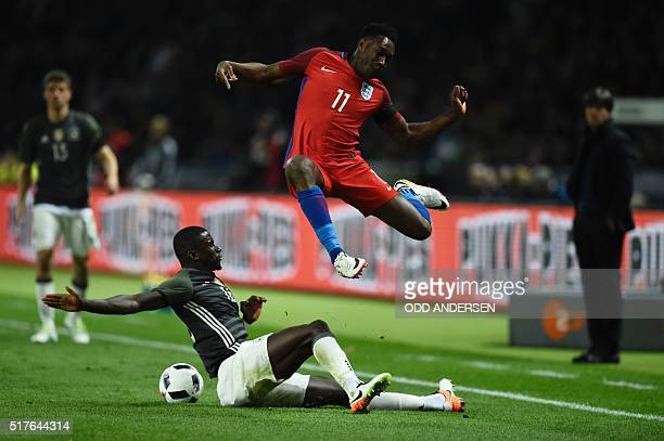 TOPSHOT England's striker Danny Welbeck Germany's defender Antonio Ruediger vie for the ball during the friendly football match Germany v England at...
