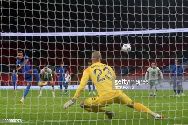 England's striker Dominic Calvert-Lewin scores their third goal from the penalty spot during the international friendly football match between...