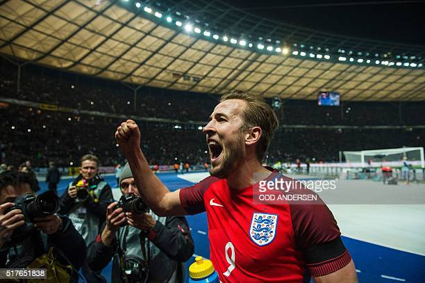 Englands striker Harry Kane acknowledges the travelling fans at the end of the friendly football match Germany v England at the Olympic stadium in...
