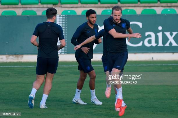 England's striker Harry Kane and England's defender Joe Gomez take part in a training session at the Ciudad Deportiva Luis del Sol in Sevilla on...