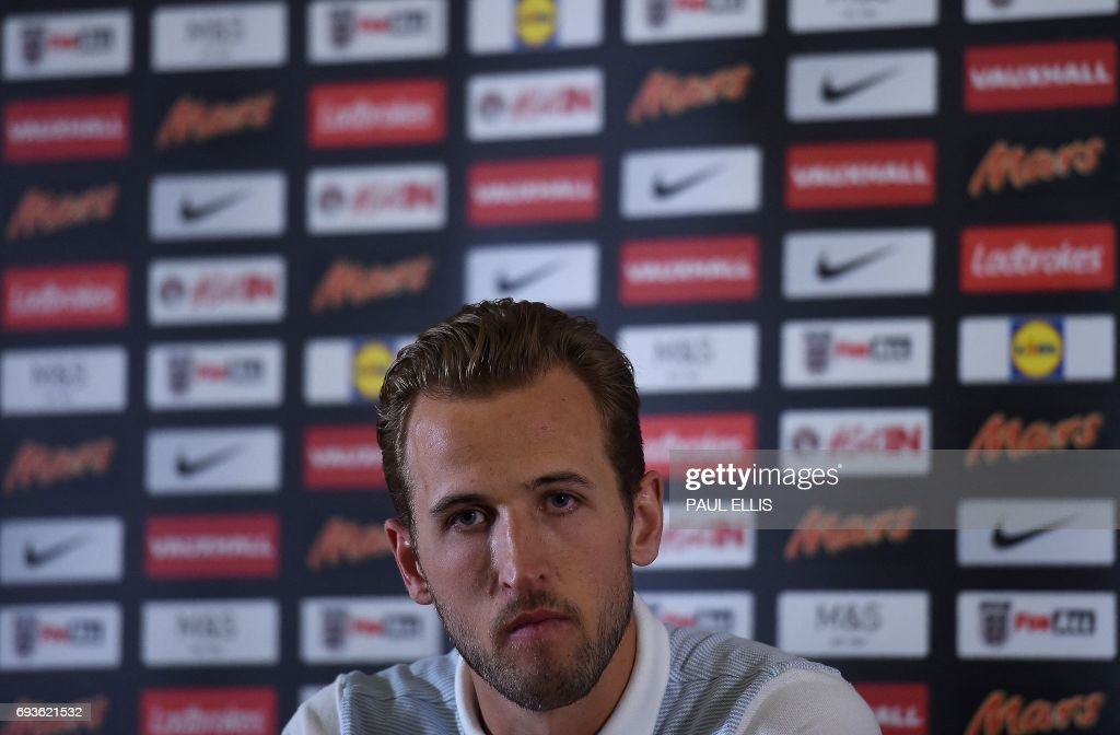 England's striker Harry Kane attends a press confrence at the team's St George's Park training centre in Burton-on-Trent, central England on June 6, 2017. Wayne Rooney's international career looks over after England's all-time top-scorer was left out of the squad for next month's World Cup qualifier against Scotland and a friendly in France. / AFP PHOTO / Paul ELLIS / NOT