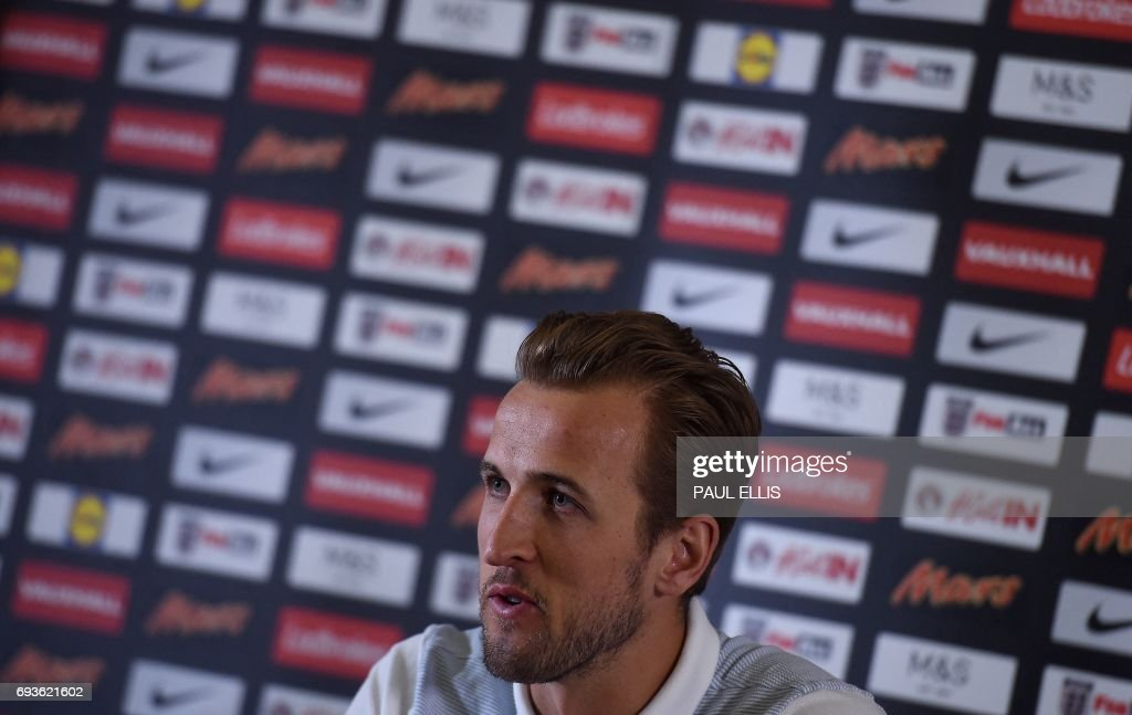 England's striker Harry Kane attends a press confrence at the team's St George's Park training centre in Burton-on-Trent, central England on June 6, 2017. Wayne Rooney's international career looks over after England's all-time top-scorer was left out of the squad for next month's World Cup qualifier against Scotland and a friendly in France. /