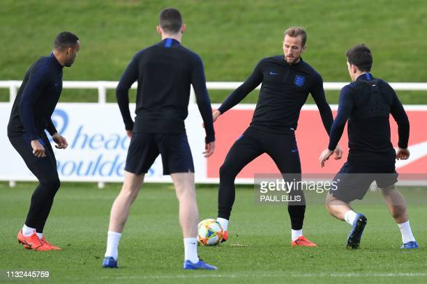 England's striker Harry Kane attends an England team training session at St George's Park in BurtononTrent central England on March 24 ahead of their...