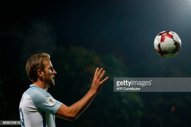 England's striker Harry Kane catches the ball on the touchline during the 2018 FIFA World Cup European Qualifying football match between Lithuania...