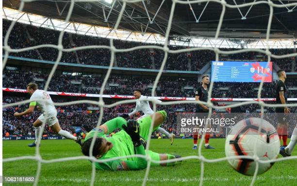 England's striker Harry Kane celebrates after his shot beats Croatia's goalkeeper Lovre Kalinic for their second goal during the international UEFA...