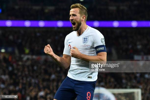 England's striker Harry Kane celebrates after scoring their second goal during the UEFA Euro 2020 qualifying first round Group A football match...