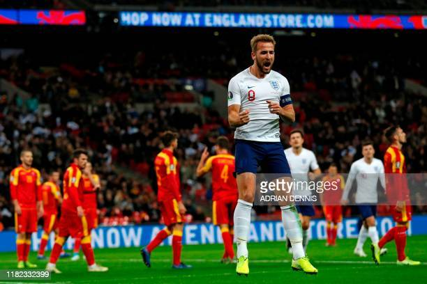 England's striker Harry Kane celebrates after scoring their third goal during the UEFA Euro 2020 qualifying first round Group A football match...