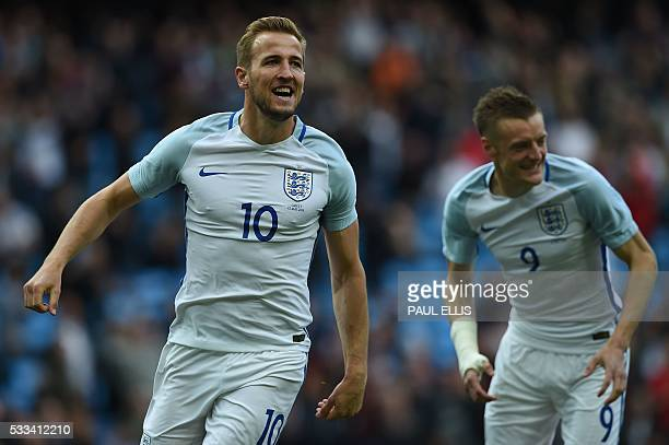 England's striker Harry Kane celebrates scoring his team's first goal with England's striker Jamie Vardy during the friendly football match between...