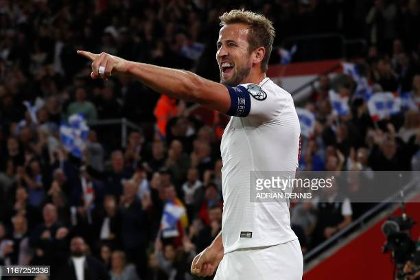 England's striker Harry Kane celebrates scoring his team's second goal during the UEFA Euro 2020 qualifying Group A football match between England...