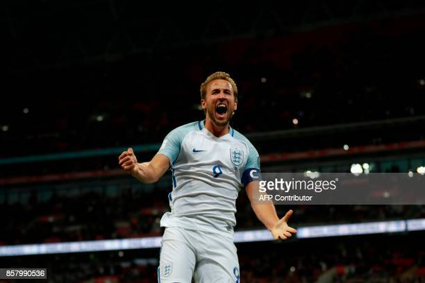 England's striker Harry Kane celebrates scoring the opening goal during the FIFA World Cup 2018 qualification football match between England and...