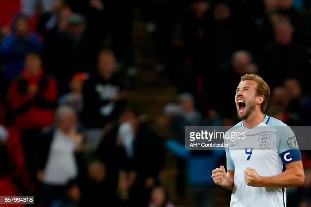 England's striker Harry Kane celebrates their 10 victory at the end of the FIFA World Cup 2018 qualification football match between England and...