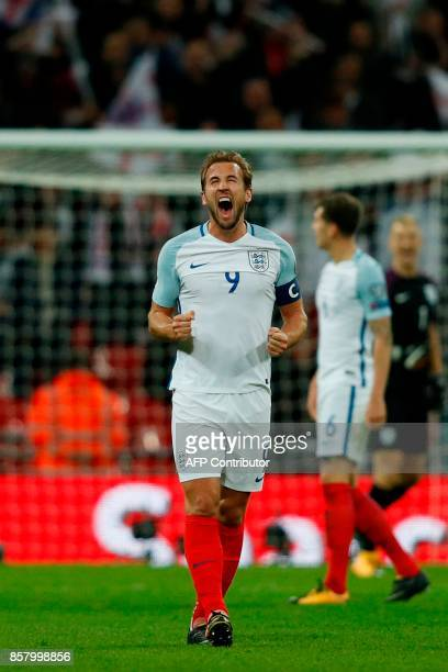 England's striker Harry Kane celebrates their 10 victory at the fulltime whistle during the FIFA World Cup 2018 qualification football match between...