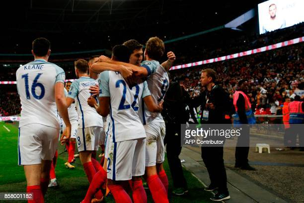 England's striker Harry Kane celebrates with teammates after scoring the opening goal during the FIFA World Cup 2018 qualification football match...
