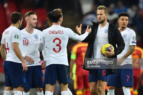 England's striker Harry Kane holding the match ball thanks his teammates on the pitch after the UEFA Euro 2020 qualifying first round Group A...