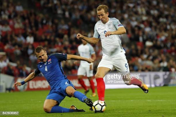 England's striker Harry Kane is tackled by Slovakia's defender Jan Durica during the World Cup 2018 qualification football match between England and...
