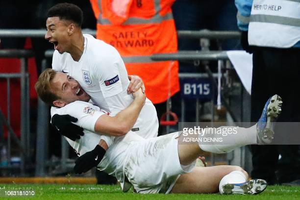 England's striker Harry Kane lies on the floor as England's midfielder Jesse Lingard celebrates after Kane scores their second goal during the...