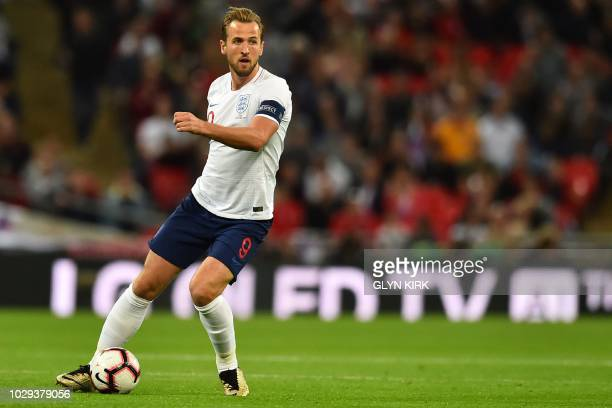 England's striker Harry Kane looks to pass the ball during the UEFA Nations League football match between England and Spain at Wembley Stadium in...