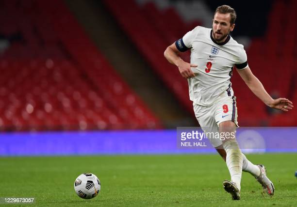 England's striker Harry Kane runs with the ball during the UEFA Nations League group A2 football match between England and Iceland at Wembley stadium...