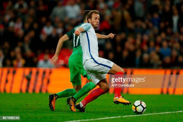 England's striker Harry Kane scores the opening goal during the FIFA World Cup 2018 qualification football match between England and Slovenia at...
