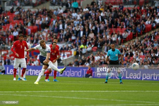 England's striker Harry Kane shoots from the penalty spot to score his team's fourth and his hatrick during the UEFA Euro 2020 qualifying first round...