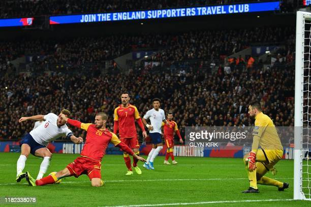 England's striker Harry Kane shoots to score his third goal England's fifth during the UEFA Euro 2020 qualifying first round Group A football match...