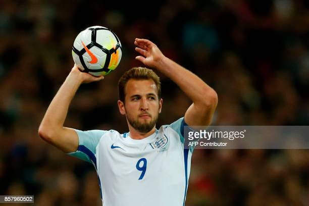 England's striker Harry Kane takes a throwin during the FIFA World Cup 2018 qualification football match between England and Slovenia at Wembley...