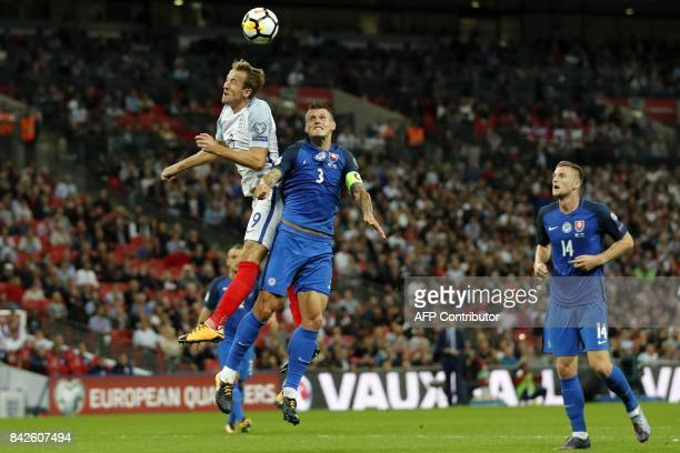 England's striker Harry Kane vies with Slovakia's defender Martin Skrtel during the World Cup 2018 qualification football match between England and...