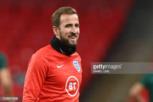 England's striker Harry Kane warms up before the UEFA Nations League group A2 football match between England and Denmark at Wembley stadium in north...