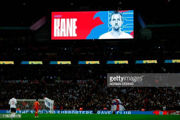 England's striker Harry Kane's picture is shown on the scoreboard during the UEFA Euro 2020 qualifying first round Group A football match between...