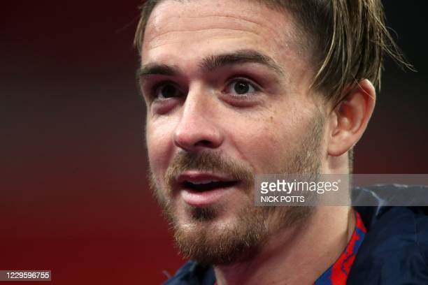 England's striker Jack Grealish does an interview on the pitch after the international friendly football match between England and Republic of...