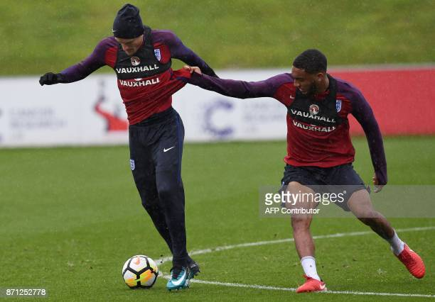 England's striker Jamie Vardy and England's defender Joseph Gomez attends a training session at St George's Park in BurtononTrent on November 7 ahead...