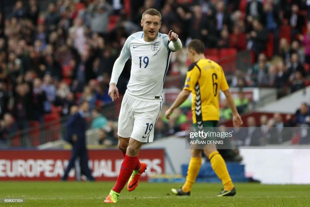 England's striker Jamie Vardy celebrates after scoring their second goal during the World Cup 2018 qualification football match between England and Lithuania at Wembley Stadium in London on March 26, 2017. / AFP PHOTO / Adrian DENNIS / NOT