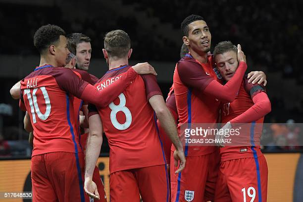 England's striker Jamie Vardy celebrates with his teammates after scoring the 22 during the friendly football match Germany vs England at the Olympic...