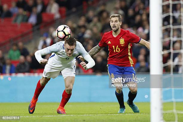 England's striker Jamie Vardy dives past Spain's defender Inigo Martinez to score his team's second goal during the friendly international football...