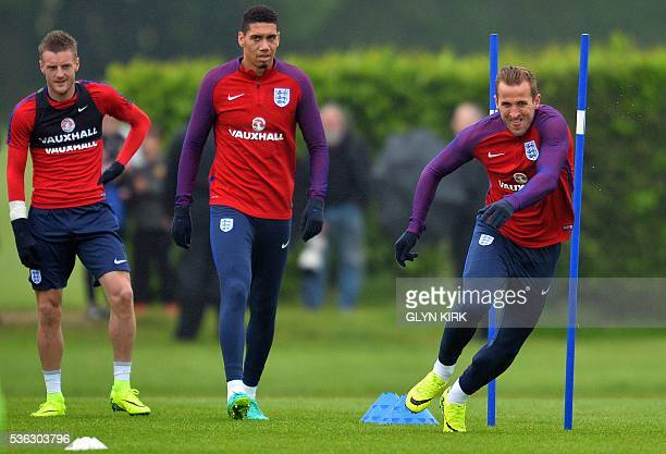 England's striker Jamie Vardy England's defender Chris Smalling and England's striker Harry Kane take part in a team training session in Watford...
