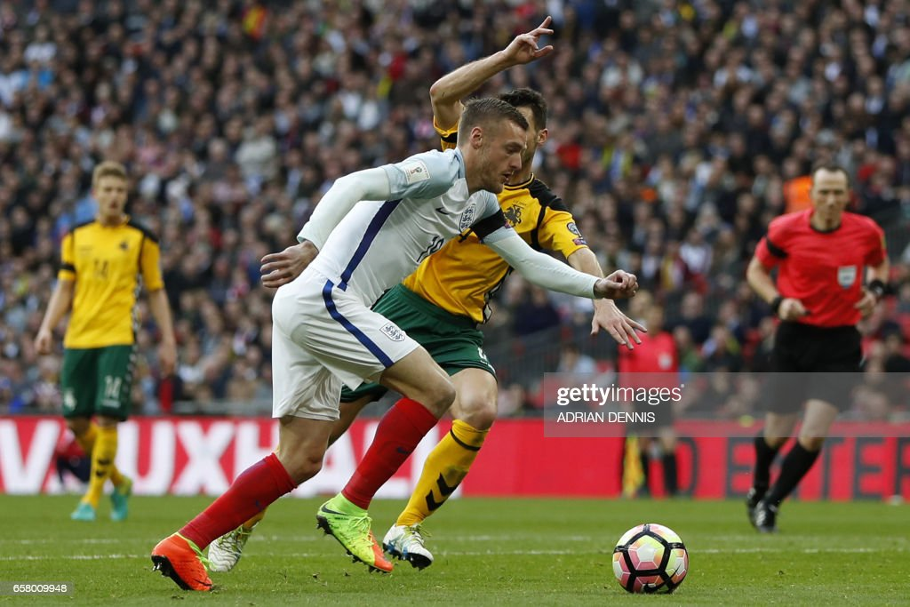England's striker Jamie Vardy gets clear on his way to scoring their second goal during the World Cup 2018 qualification football match between England and Lithuania at Wembley Stadium in London on March 26, 2017. / AFP PHOTO / Adrian DENNIS / NOT