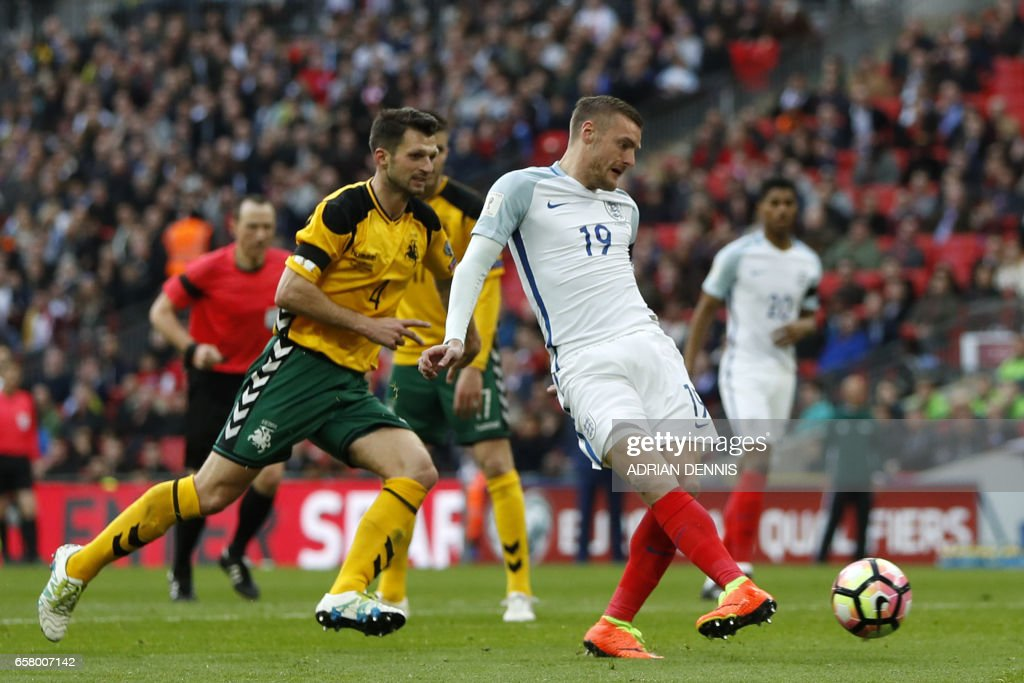 England's striker Jamie Vardy (R) shoots to score their second goal during the World Cup 2018 qualification football match between England and Lithuania at Wembley Stadium in London on March 26, 2017. / AFP PHOTO / Adrian DENNIS / NOT